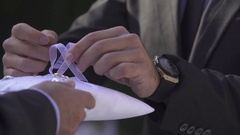 Wedding ring unfold, slow-mo Stock Footage