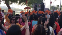 People celebrating a street wedding in Udaipur, India Stock Footage