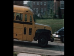 Kids with lunchboxes board antique school bus 1957 Stock Footage