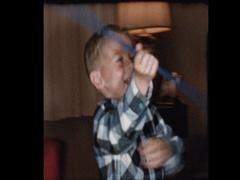 Cute blond boy plays majorette tosses batton Stock Footage