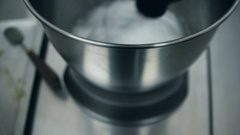 Close up: Whisks whipped egg whites and sugar in the bowl of glass Stock Footage