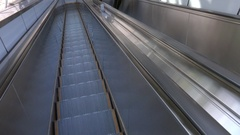 Happy Asian Businesswoman Talking On Mobile Phone On Escalator Stock Footage