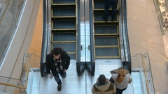 People use escalator in Ocean Plaza shopping centre Stock Footage