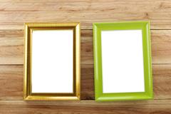 Vintage Photo frame on wooden background. Stock Photos