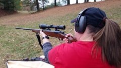Woman firing long range rifle 4K Stock Footage