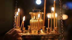 Hand parishioners of the lights and lighting a candle Stock Footage
