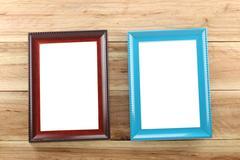 Vintage Photo frame on wooden background. Stock Photos