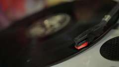 Closeup of vinyl record spinning on retro player, vintage music collection Stock Footage