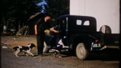 Gas station attendant loads dogs, goes home after work, 3949 vintage home movie Stock Footage