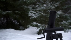 Mortar fired and is smoking after a shot in the winter forest Stock Footage
