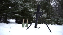 Mortar is charged and ready to fire in the winter forest Stock Footage
