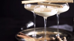 Egg nog cocktail in tall glasses on the tray at the minibar. Stock Footage