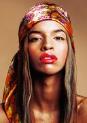 Beauty young afro american woman in shawl on head smiling close Stock Photos