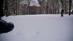 Man Walking in the Deep Snow in the Winter Forest at Snowy Day. Slow Motion Stock Footage