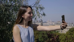 Young Woman Poses For Cute Selfies In The Parc Des Butte Chaumont, Paris, France Stock Footage