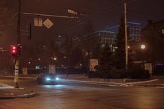 Car on city street. winter night Stock Photos