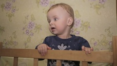 A little boy standing in cot Stock Footage