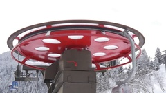 Red flywheel of chairlift Stock Footage