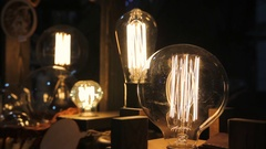 Collection of decorative Edison light bulbs, vintage objects, creative design Stock Footage