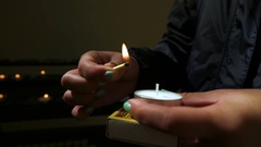 Young Woman Lights A Prayer Candle At The Oude Kerk (Old Church) Stock Footage