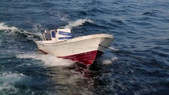 Small boat tied to the back of big ship Stock Footage