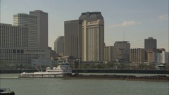 Barge through New Orleans skyline Stock Footage