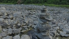 Small inukshuk on stream Stock Footage