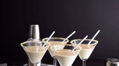 Egg nog cocktail in glasses rimmed with brown sugar at the minibar. Stock Footage