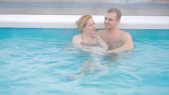 Hot spring geothermal spa. Romantic couple in love relaxing in hot pool. Stock Footage