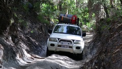 4x4 vehicle driving bumpy sand track on Fraser Island Stock Footage