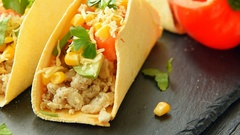 Tacos with lime, corn, chicken, pepper, tomato, avocado, cheese and parsley Stock Footage