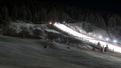 Ski run and chairlift at night Stock Footage