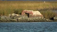 Cemetary coastal erosion cu Stock Footage