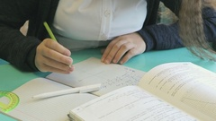 Schoolgirl writes in her copybook at the lesson Stock Footage