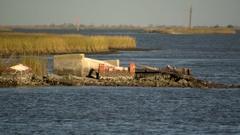 Cemetary coastal erosion ms Stock Footage