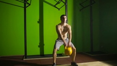 Young athletic man doing kettlebell swing exercise at the gym. CrossFit Stock Footage