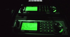 Police radio scanner in TV news vehicle Stock Footage