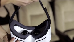 Young woman puts on virtual reality headset. Shooting first-person. Stock Footage