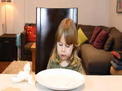 Little child eating pizza at home Stock Footage