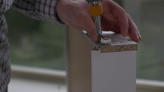Man installs slide on drawer Stock Footage