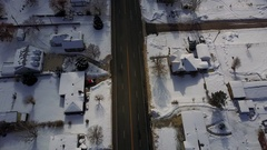 Aerial winter rural town main street homes traffic 4K Stock Footage