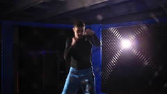A young man trained in a cage. A fight with a shadow Stock Footage