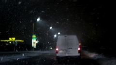 Urban Traffic, Driving in the Night Snowfall, Blizzard, Ice Storm, Non-Flying Stock Footage