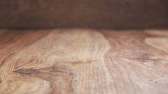 Clementine rolling on wood table in slow motion Stock Footage