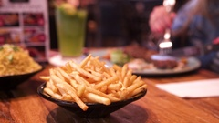 Chips and kebab in a restaurant Stock Footage