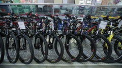 Mountain bikes in sports shop Stock Footage