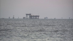 Oil rigs in gulf of mexico pan  Stock Footage
