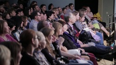 Spectators watch the show in the theater. People in the audience Stock Footage