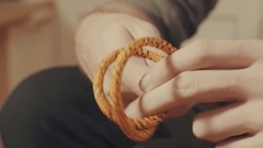 Man's hands tying a mountaineering knot on a rope Stock Footage