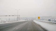 Driving POV on snowy  road.  Snow storm driving urban street fast timelapse.. Stock Footage